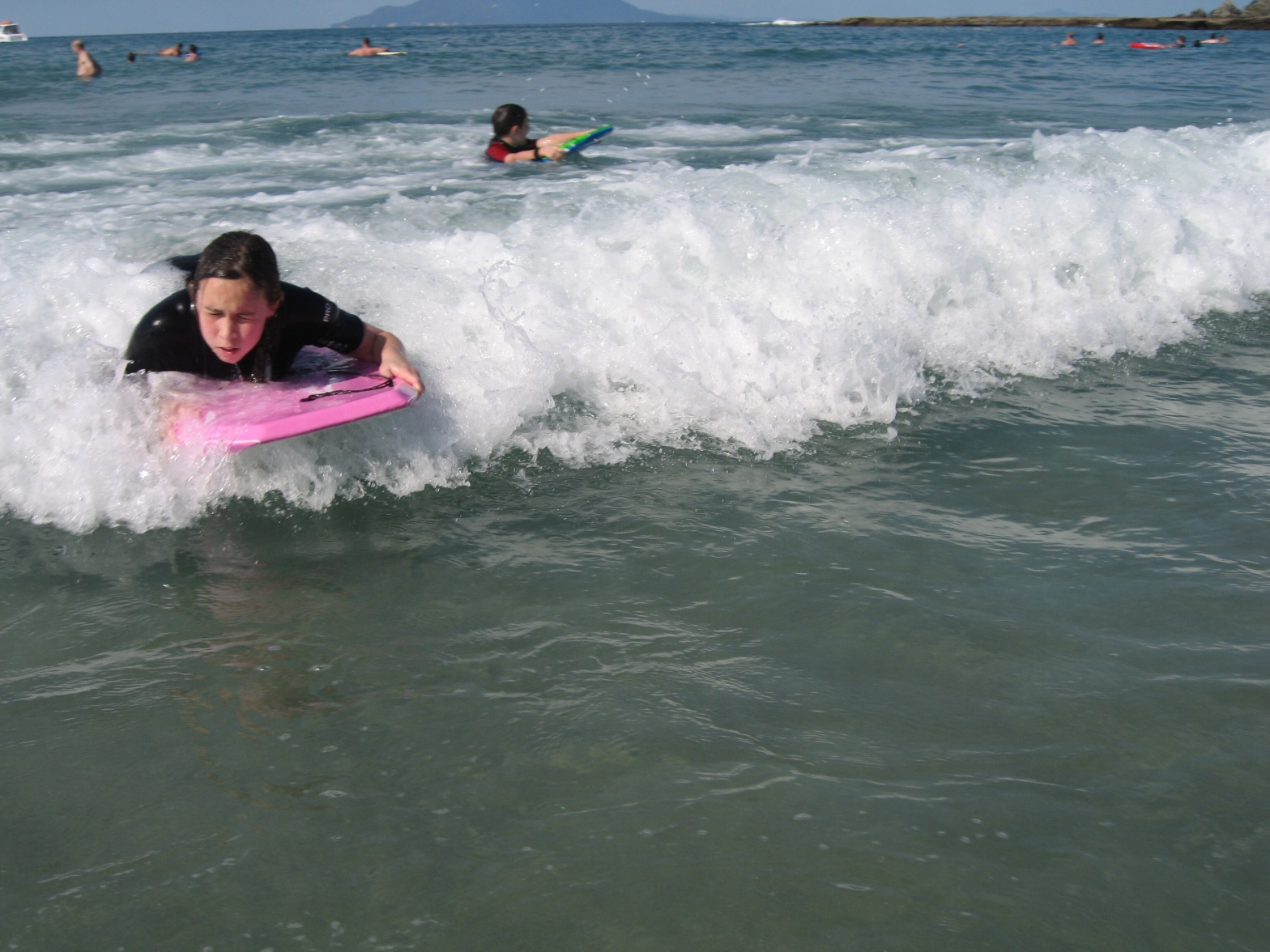 Me on buggy board skimming onto the sand